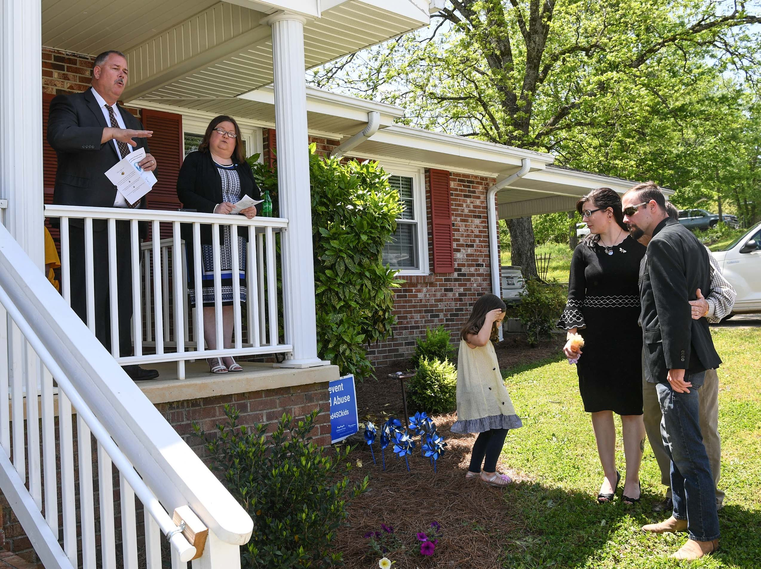 "David Wagner, left, Tenth Circuit Solictor, and Tracy Whitten Bowie, right, Foothills Alliance Executive Director, begin an office dedication of the Foothills Alliance Oconee County Gwynnie Bee House, with family of the late Gwynne Ann-Marie Hess, right, in Walhalla Friday. Foothills Alliance, who with partners provides education, advocacy, and treatment services to prevent sexual assault trauma and child abuse services in Anderson and Oconee Counties, branched out from their Anderson office with an office in Walhalla last August. Gwynne Ann-Marie Hess, ""Gwynnie Bee"", died in 2017 from child abuse, and the office was renamed after her Friday in the presence of family, law enforcement, Sen. Thomas Alexander, Oconee County Sheriff Michael Crenshaw, and Tenth Circuit Solicitor David Wagner."