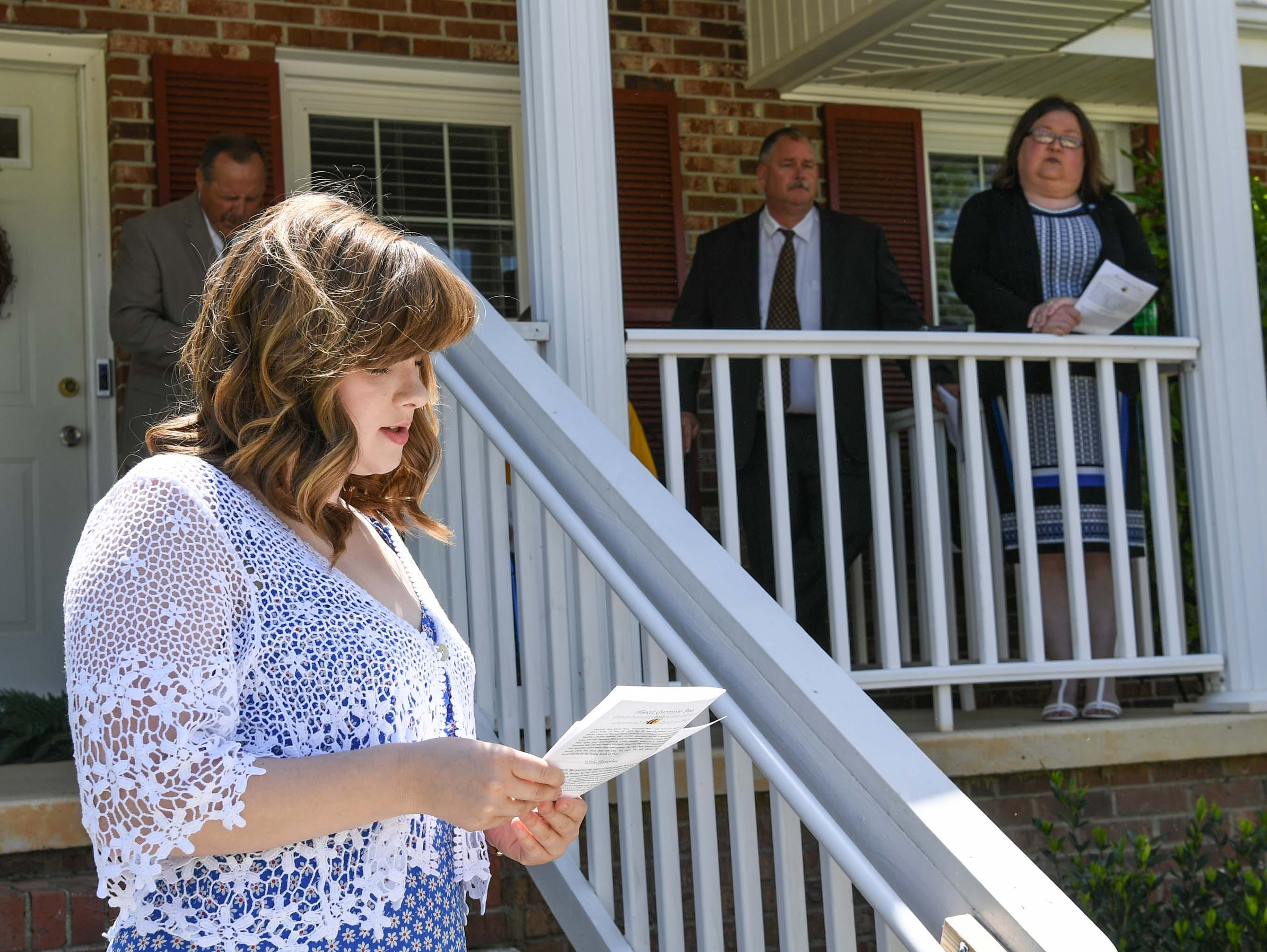 "Emily Wyndham, Foothills Alliance forensic interviewer, offers a poem during an office dedication of the Foothills Alliance Oconee County Gwynnie Bee House in Walhalla Friday. Foothills Alliance, who with partners provides education, advocacy, and treatment services to prevent sexual assault trauma and child abuse services in Anderson and Oconee Counties, branched out from their Anderson office with an office in Walhalla last August. Gwynne Ann-Marie Hess, ""Gwynnie Bee"", died in 2017 from child abuse, and the office was renamed after her Friday in the presence of family, law enforcement, Sen. Thomas Alexander, Oconee County Sheriff Michael Crenshaw, and Tenth Circuit Solicitor David Wagner."