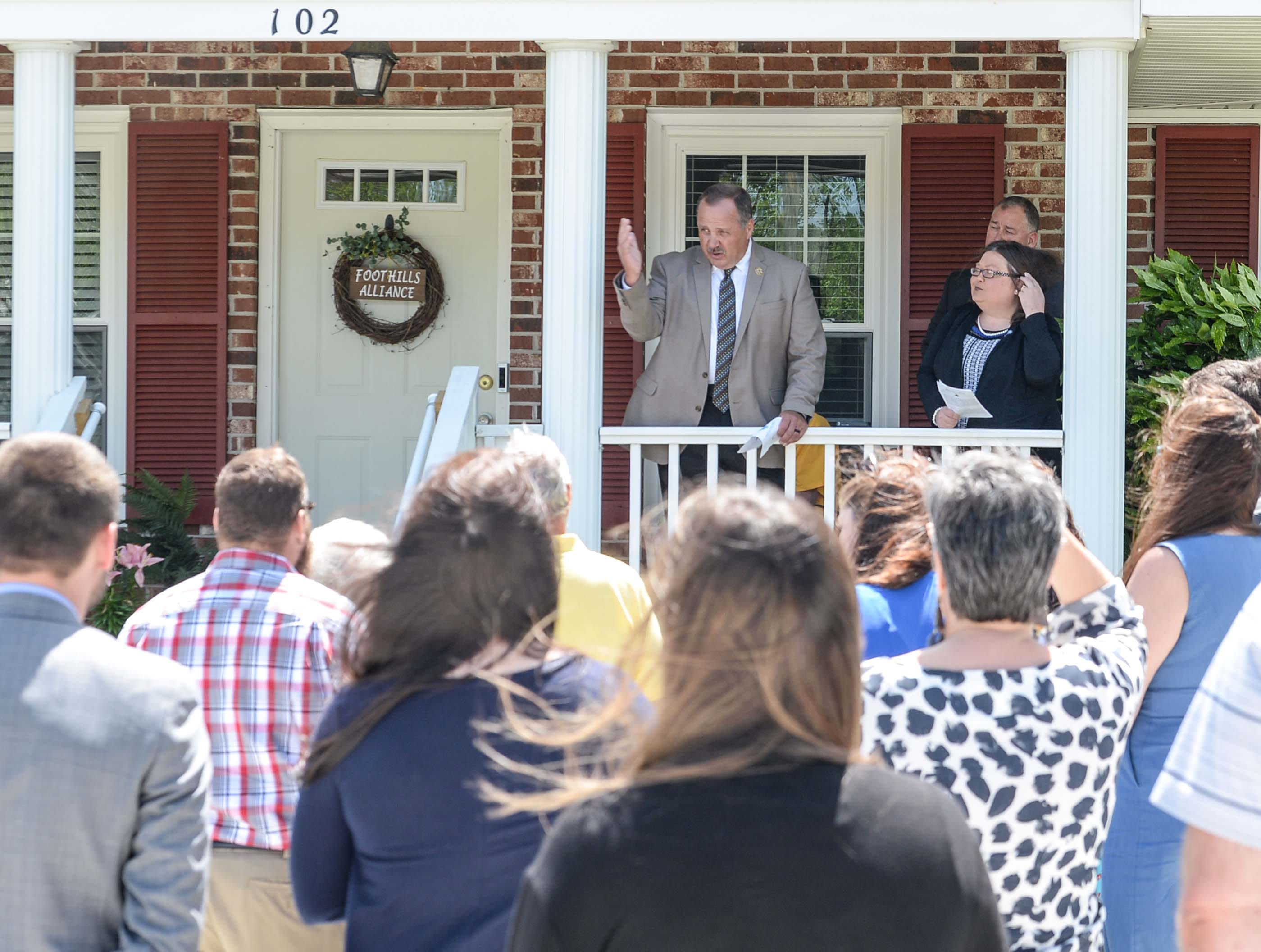 "Oconee County Sheriff Michael Crenshaw speaks during an office dedication of the Foothills Alliance Oconee County Gwynnie Bee House in Walhalla Friday. Foothills Alliance, who with partners provides education, advocacy, and treatment services to prevent sexual assault trauma and child abuse services in Anderson and Oconee Counties, branched out from their Anderson office with an office in Walhalla last August. Gwynne Ann-Marie Hess, ""Gwynnie Bee"", died in 2017 from child abuse, and the office was renamed after her Friday in the presence of family, law enforcement, Sen. Thomas Alexander, Oconee County Sheriff Michael Crenshaw, and Tenth Circuit Solicitor David Wagner."