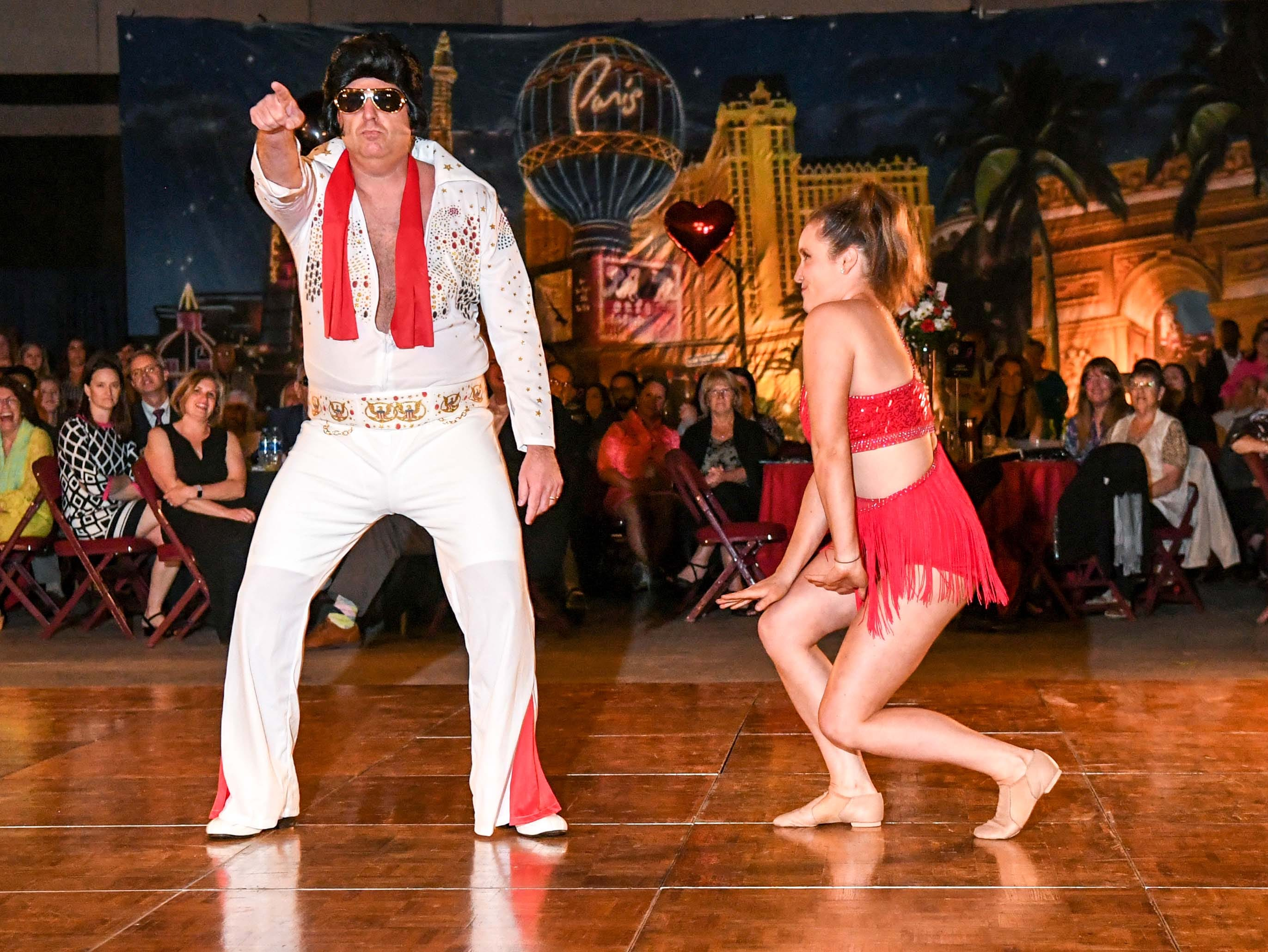 "Carter Knobel, left, and Addy Smith dance to songs by Elvis Presley during the 13th Dancing For Our Heroes event with the theme ""Welcome to Las Vegas"" at the Civic Center of Anderson Thursday. The dance couple raised money for Anderson Arts Center. The ten dance couples raised money for different charities, dancing to acts who have residencies in Las Vegas."