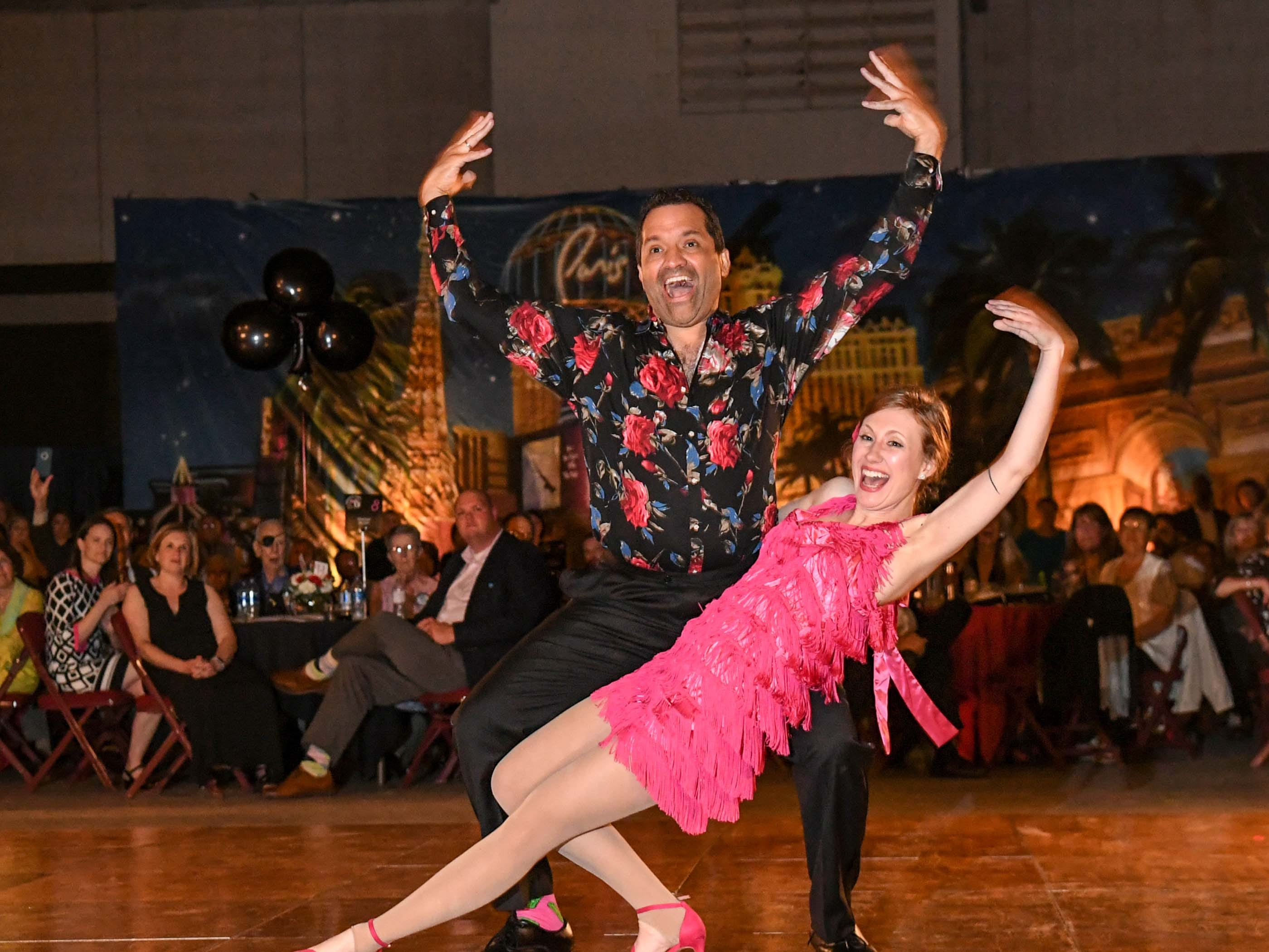 "Dr. Vidal Desradel, left, and Ashley Casey dance to Harry Belefonte music during the 13th Dancing For Our Heroes event with the theme ""Welcome to Las Vegas"" at the Civic Center of Anderson Thursday. The ten dance couples raised money for different charities, dancing to acts who have residencies in Las Vegas."