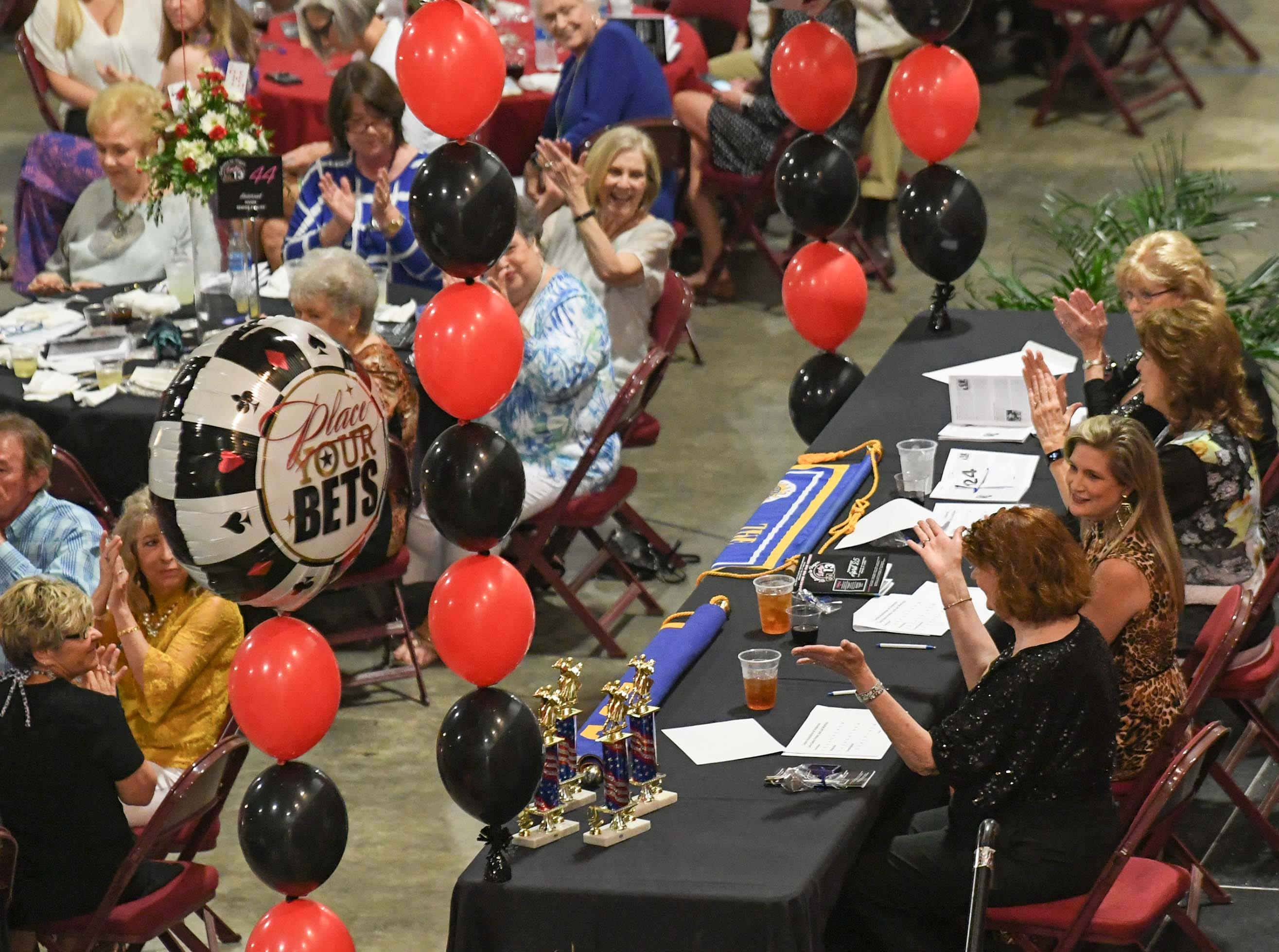 "Judges Mary Ann McBride, Amy Coleman, Cathy Golson, and Yvonne Conover are introduced during the 13th Dancing For Our Heroes event with the theme ""Welcome to Las Vegas"" at the Civic Center of Anderson Thursday."