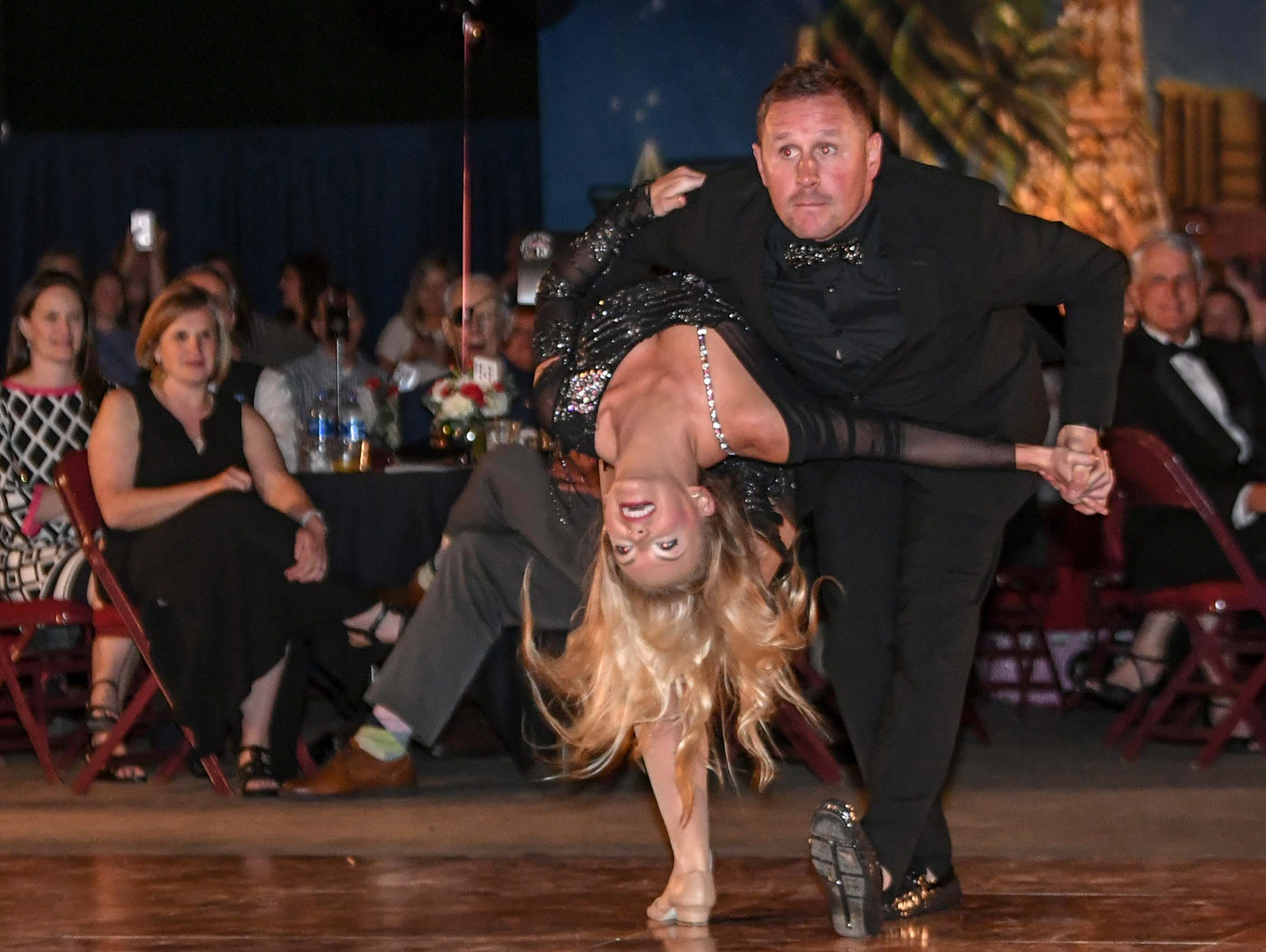 "Jeremy Caldwell, right, and Ansley Cartee dance to a medley of songs by Britney Spears during the 13th Dancing For Our Heroes event with the theme ""Welcome to Las Vegas"" at the Civic Center of Anderson Thursday. The dance couple raised $35,848 for AnMed Health Foundation. The ten dance couples raised money for different charities, dancing to acts who have residencies in Las Vegas."