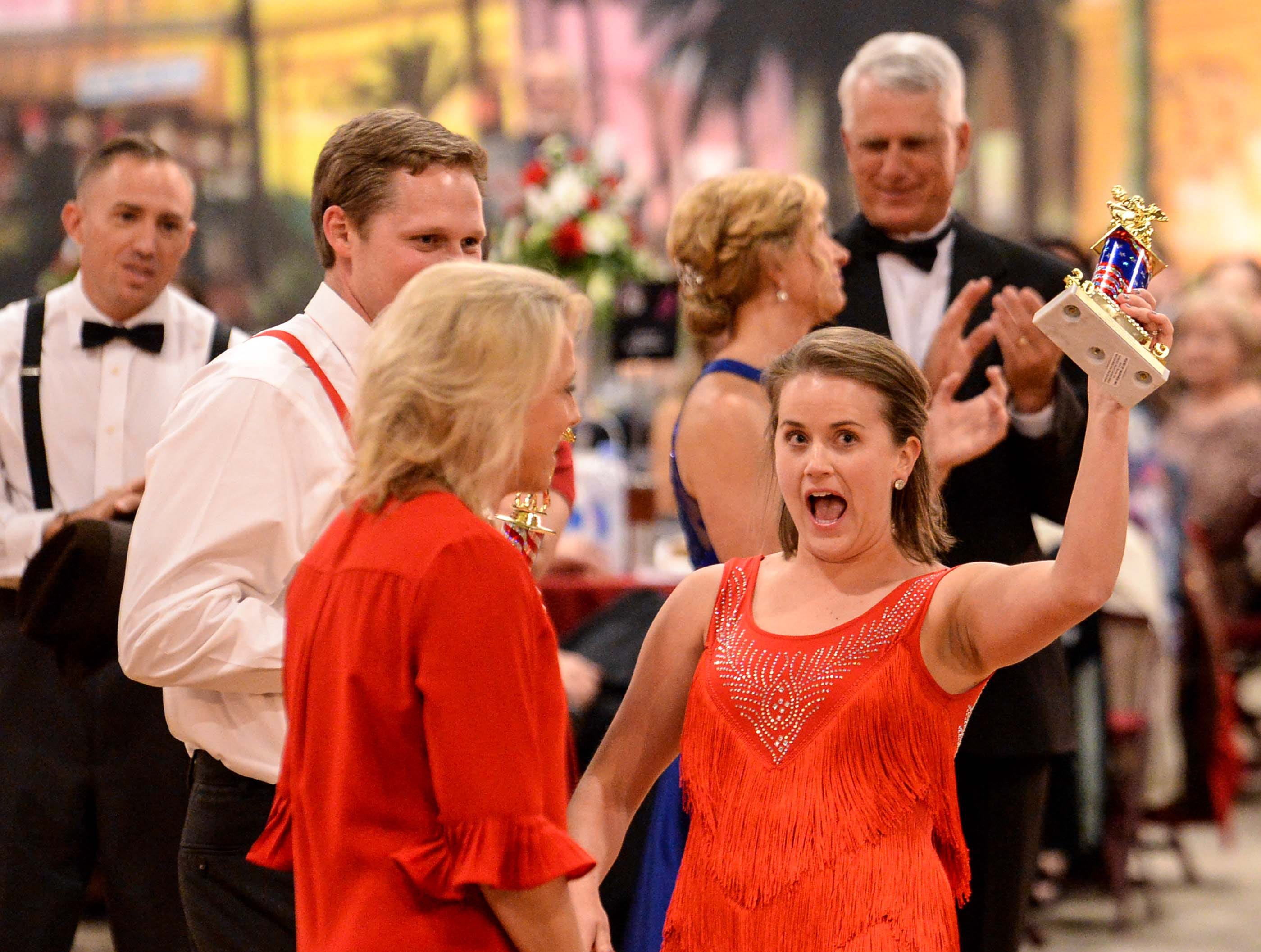 "Mary Pat Smith, right, with her dance partner Parker Smith, left, reacts and holds up the judges choice award during the 13th Dancing For Our Heroes event with the theme ""Welcome to Las Vegas"" at the Civic Center of Anderson Thursday. The couple, raising money for Junior League of Anderson, danced to Tina Turner's ""Proud Mary."" Dancers represented 10 charities, dancing to acts who have residencies in Las Vegas."