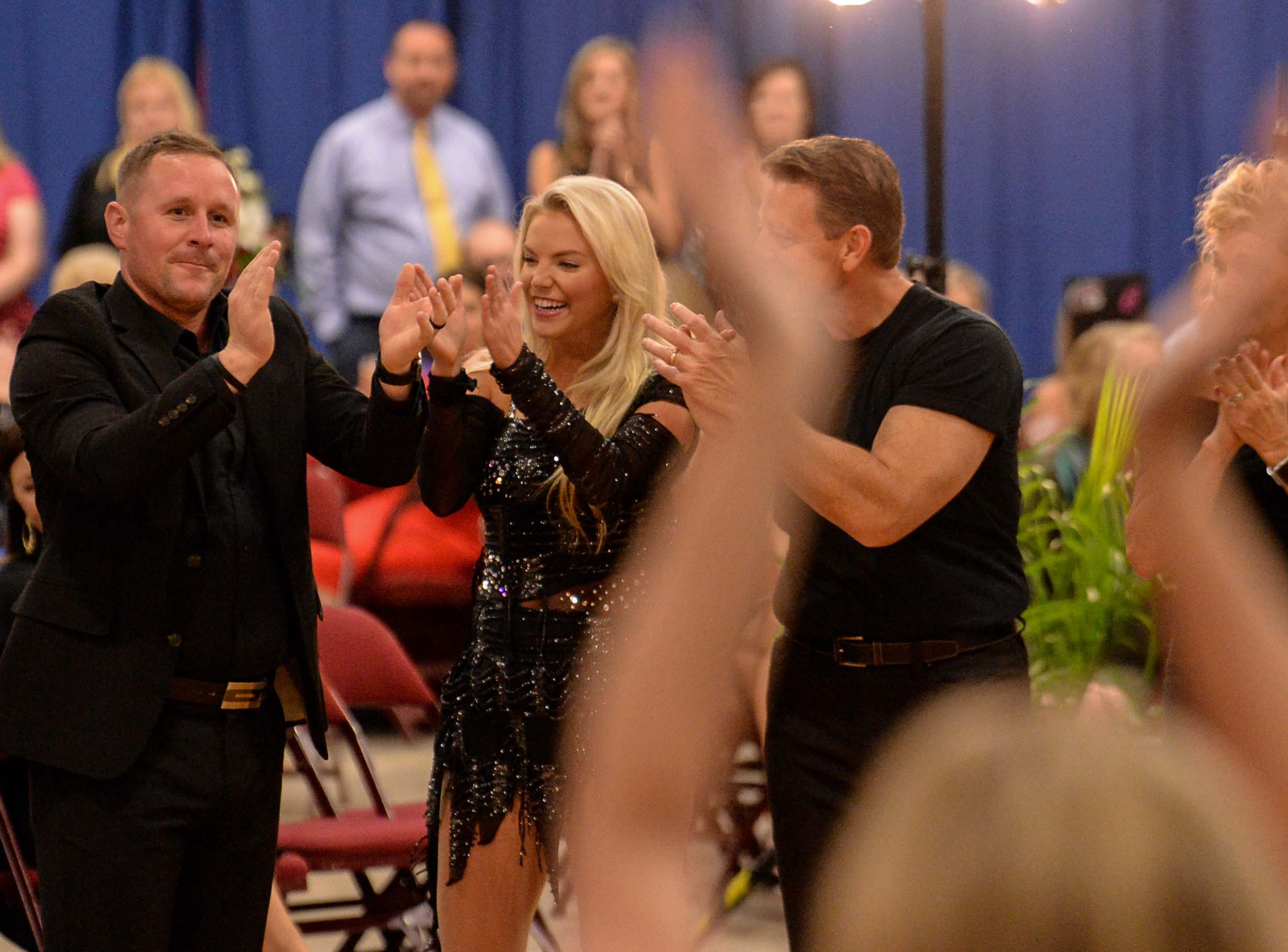 "Jeremy Caldwell, left, and Ansley Cartee react winning the most money raised trophy during the 13th Dancing For Our Heroes event with the theme ""Welcome to Las Vegas"" at the Civic Center of Anderson Thursday. The dance couple raised $35,848 for AnMed Health Foundation. The couple danced to song by Britney Spears. The ten dance couples raised money for different charities, dancing to acts who have residencies in Las Vegas."