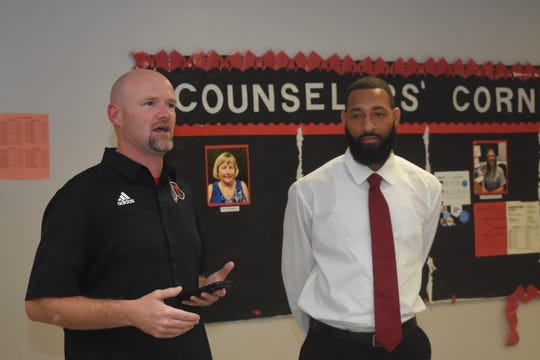 "Antonio ""Okie"" Benjamin (right) was announced as the new head coach for the Tioga High School boys' basketball team Thursday evening. Benjamin comes to Tioga from Avoyelles Public Charter School in Mansura where he was the physical education teacher and basketball coach. Tioga athletic director and head football coach Kevin Cook (left) says a few words about Benjamin and Tioga High School."