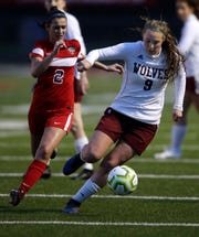 Winneconne High School's Madeline Young (9) is on the move against Appleton East High School's Ellie Behnke (2) during their girls soccer game Thursday, April 25, 2019, in Appleton, Wis. 