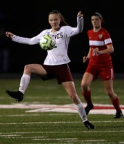 Winneconne's Emily Heyroth controls the ball against Appleton East during a game last month in Appleton.