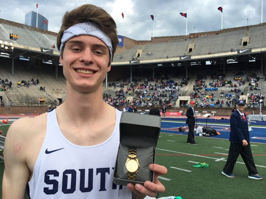 Middletown South's Mark Anselmi holds up his winner's watch.