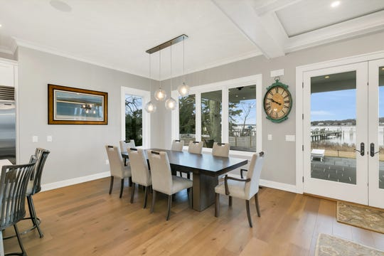 The dining room offers a set of French doors with custom windows.