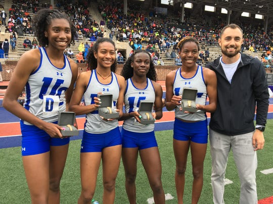 Union Catholic's girls 4x800, left to right: Morgan Williams, Leena Morant, Ashleigh Patterson and Jerika Lufrano with coach Mike McCabe