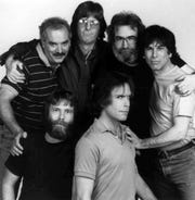 Members of the Grateful Dead pose in a 1985 file photo in Marin County, California. From left, back row, are Bill Kreutzman, Phil Lesh, Jerry Garcia, and Mickey Hart. In front are Brent Mydland, left, and Bob Weir.