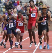 Semaj Willis takes the baton from Sterling Pierce of Rutgers, running the third leg of the college 4x400 relay for his team. Rutgers finished in 13th place overall and 4th in this heat with a time of 3:11.43.