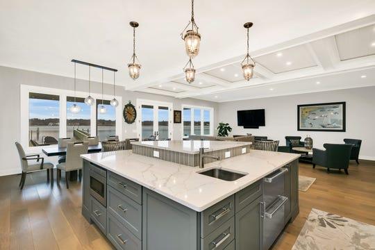 The designer kitchen with Calcutta Carrara Quartz, Wolf and Sub-Zero appliances  and Omega cabinetry