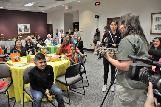 Abilene Zoo education curator Joy Harsh holds a tegu during a Hendrick Children's Hospital news conference Friday to announce it now has available the San Diego Zoo Kids closed-circuit channel. Local zoo animals also will be on the channel.
