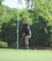 Clyde junior Taylor Ancheta watches her shot at the Region I-3A girls golf tournament Thursday at Shady Oaks Golf Course in Baird.