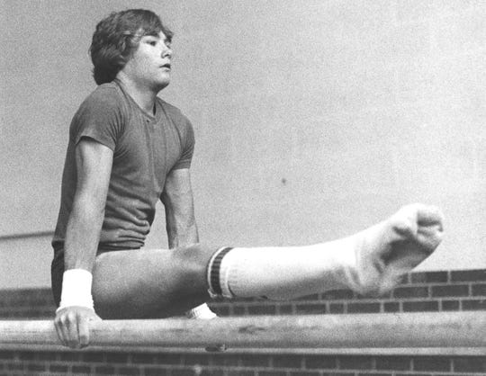 Mark Oates does a routine on the parallel bars before heading to the 1980 regional meet with the rest of the Abilene High squad.