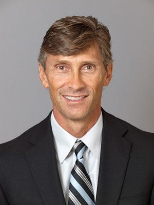 ACU women's tennis coach John Walker