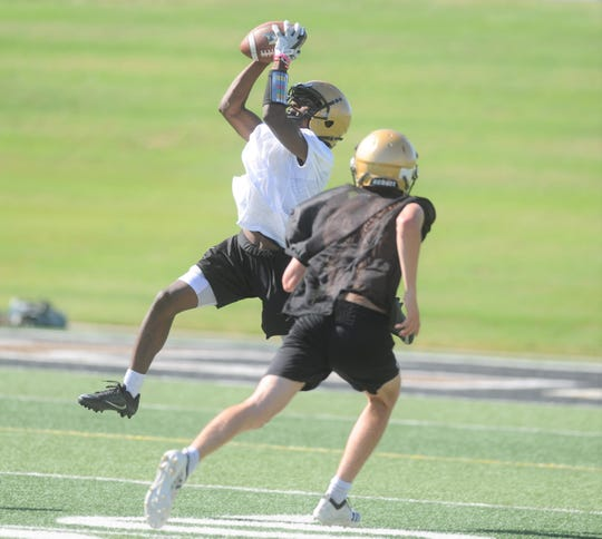 An Abilene High receiver hauls in a catch during the Eagles' practice.