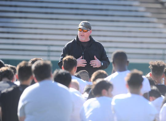 Abilene High assistant head coach Mike Fullen, who is leading the Eagles' spring football, addresses the team following the first practice Thursday at Shotwell Stadium.