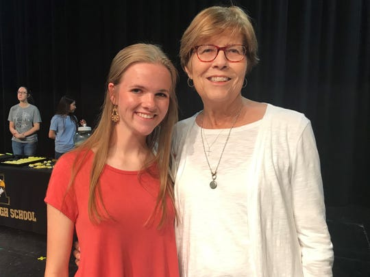 Abilene High School's eighth-ranked Class of 2019 senior Abigail Griffith, left, joins her grandmother, Carolyn Griffith, right, as members of the school's top students during a ceremony April 22. Carolyn Griffith was in the Top 25 of her own AHS graduating class 55 years ago, in 1964.