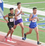 San Elizario's Rene Arambula, right, battles Snyder's Christian Escobedo, left, and Canyon's Samuel Ashley in the Class 4A 3,200 meters. Ashley finished second with a time of 9:54.78, behind San Elizario's Edwin Gomez (9:54.19), while Arambula was third (10:03.50). Escobedo was fourth (10:06.24) at the Region I-4A track and field meet.