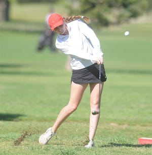 Eastland's Taylor Hodges tees off on the first hole at the Region I-3A girls golf tournament at Shady Oaks Golf Course in Baird.