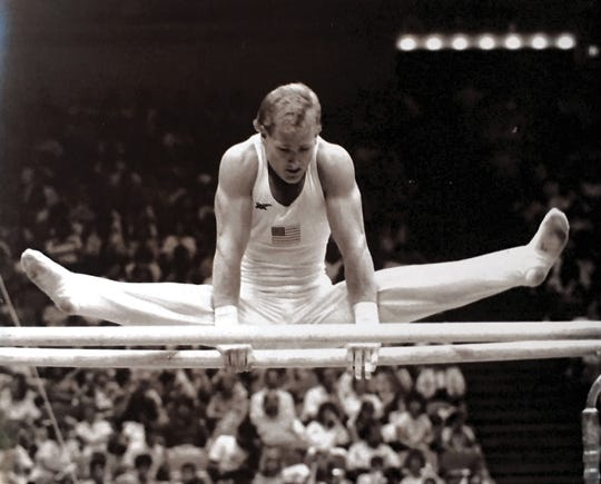 Mark Oates on the parallel bars