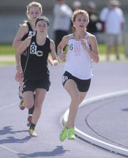 Clyde junior Megan Smith (8) runs behind Holliday's Hannah Spears during the 3,200-meter run at the Region I-3A track meet Friday, April 26, 2019, at Abilene Christian's Elmer Gray Stadium.
