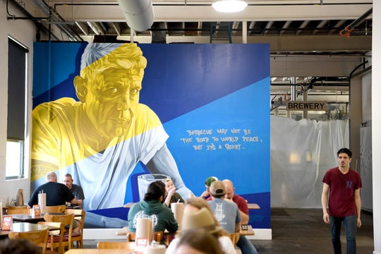 A new mural featuring Anthony Bourdain adorns one of the walls of the new Arden location of 12 Bones on Hendersonville Road in Arden.