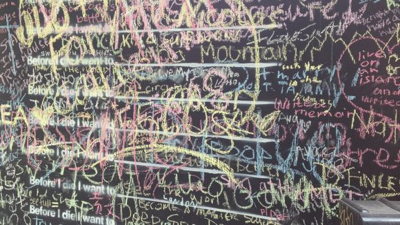 Asheville's Before I Die wall in July 2014, the week it appeared on Biltmore Avenue.