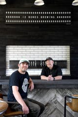 12 Bones co-owner, Bryan King and brewmaster, Scott Hetig, at the new 12 Bones Brewing located adjacent to the restaurant's new Arden location on Hendersonville Road. The brewery will open May 1 with 10 of their own beers brewed by Hetig.