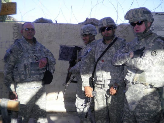 "Justin ""Goose"" Shelton, far right, was a Specialist E4 while completing a tour as a guard inside a prison holding Iraqi detainees."