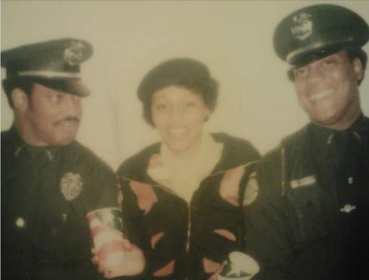 An undated photo shows officer Charles Baird, left, with friend Beverly Howell and Walt Robertson.