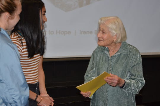 Dr. Irene Butter, a Holocaust survivor, speaks with Lakeview High School students following her presentation on Friday, April 26, 2019.