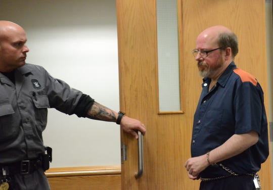 Alan Little enters the courtroom for his preliminary examination.