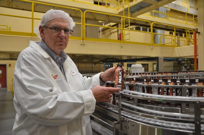 Prairie Farms General Manager of Michigan Tom Davis shows off the new milk product the company is offering with an extended shelf life. The product is made at Prairie Farms Battle Creek plant.