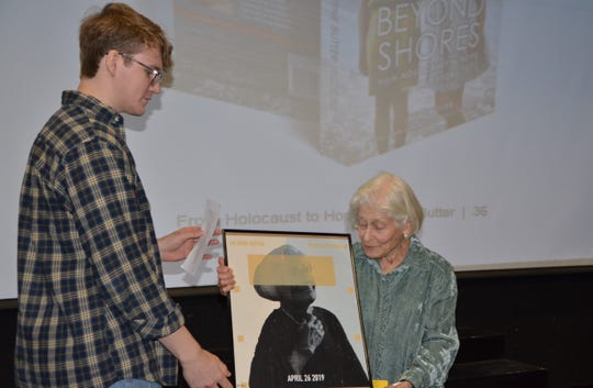 Lakeview High School senior Zach Baker presents an art piece he designed to Dr. Irene Butter on Friday, April 26, 2019.
