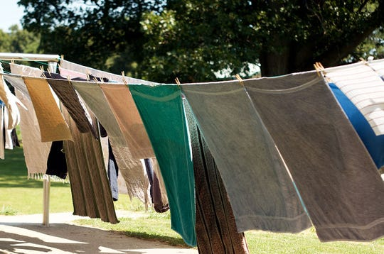 Laundry drying on the line from spring cleaning.