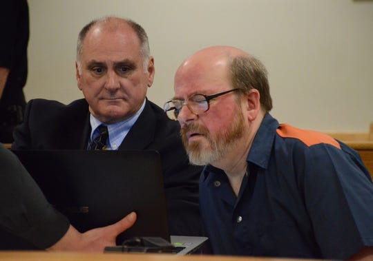 Alan Little and his attorney, John Vincent, left, are shown the pictures on a computer before they are introduced in court.