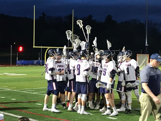 Chenango Forks lacrosse players gather during a timeout in their game against visiting Whitney Point on Thursday night. The Blue Devils won, 19-1.