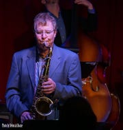 Mike Carbone plays the saxophone at a jazz session at the Schorr Family Firehouse Stage.