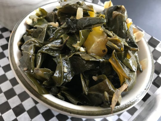 Collard greens are served up as a side at the BelAir BBQ Diner in Endicott.