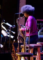 Union-Endicott High School senior Mary Orji plays the saxophone at a jazz session at the Schorr Family Firehouse Stage.