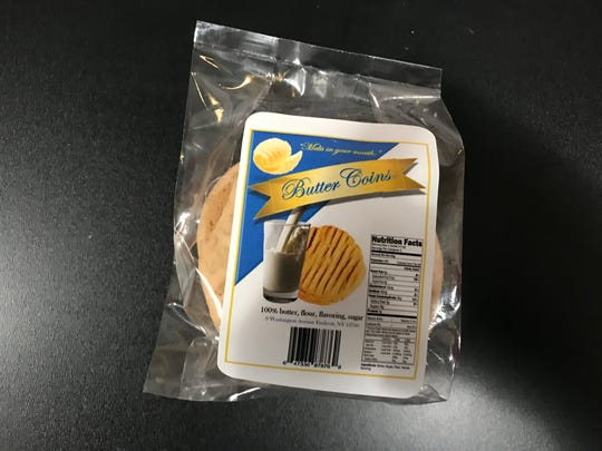 Kevin Woodard, also known as Chef DeMarcus, bakes his own Butter Coin cookies.