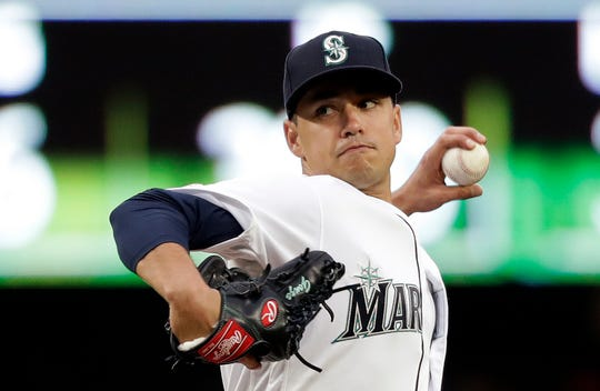 Seattle Mariners starting pitcher Marco Gonzales throws against the Texas Rangers in the first inning of a baseball game Thursday, April 25, 2019, in Seattle. (AP Photo/Elaine Thompson)