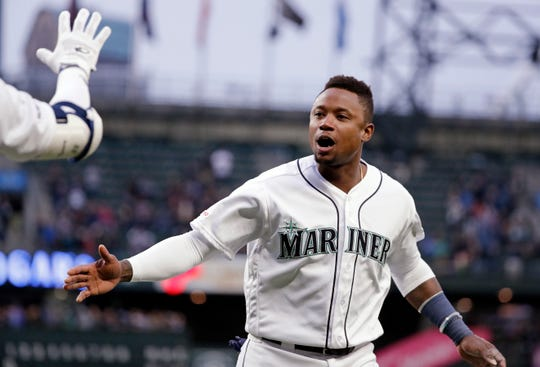 Seattle Mariners' Tim Beckham reacts after scoring against the Texas Rangers in the first inning of a baseball game Thursday, April 25, 2019, in Seattle. (AP Photo/Elaine Thompson)