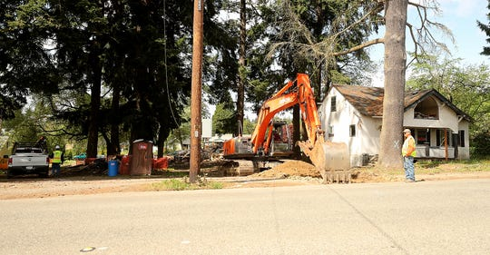 A crew works the site where the Quinault Nation plans to open a smoke shop on Callow Avenue in Bremerton on Friday.