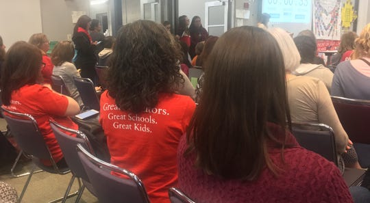 Teachers and other staff in North Kitsap School District listen as the board considers proposed cuts in the face of a projected budget shortfall.