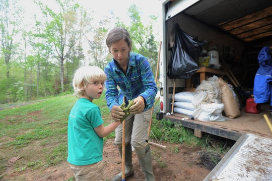 Mary Carroll Dodd and her son Xander get ready to plant crops at Red Scout Farm in Black Mountain. The farm sells its produce at the Black Mountain Tailgate Market, which returns on May 4.
